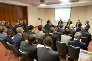 The panel discusses currency and technology at the IPE Conference in Prague