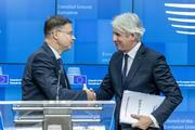 Valdis Dombrovskis and Romanian Minister for Public Finance after ECOFIN press conference