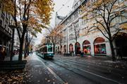 photo of tram passing through a Swiss city's shopping district