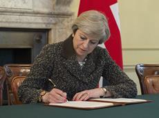 UK prime minister Theresa May signs the letter triggering Article 50