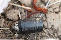 Photograph of an unexploded M85 type cluster submunition, courtesy of the Cluster Munition Coalition