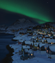 the aurora borealis covers the night sky of greenlands capital nuuk
